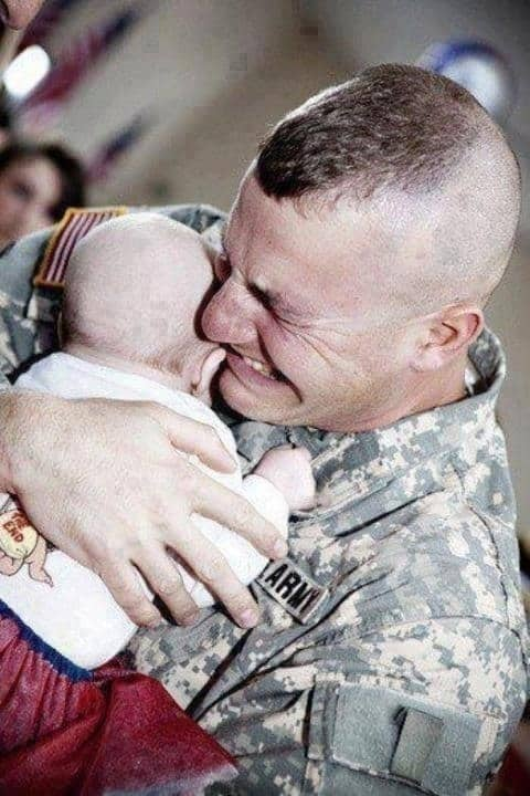 Picture of a soldier metting his baby